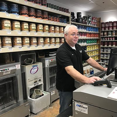 Benjamin Moore Expert in paint preparation area in Canton store