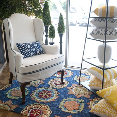 Upholstered armchair, pillows and rug in Canton store