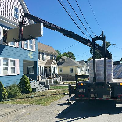 Drywall being delivered into second floor window