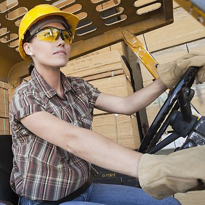 Young woman operating a forklift
