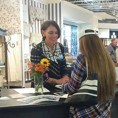 Interior designer with a customer at an event in Norwood paint and decorating store