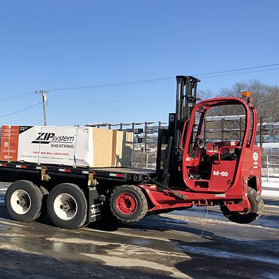 National Building Products delivery truck with mounted forklift in East Hartford
