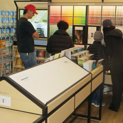 Customers in the Benjamin Moore Paints Color Selection area in Newton store