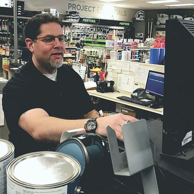 Paint expert at computer in Canton store