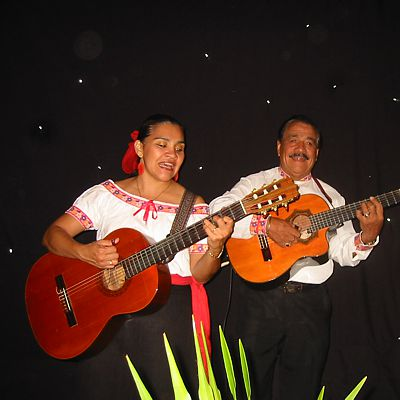 Cancun woman and man musicians playing guitars