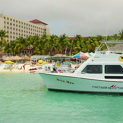 Caribbean boat with beach and hotel seen in the background