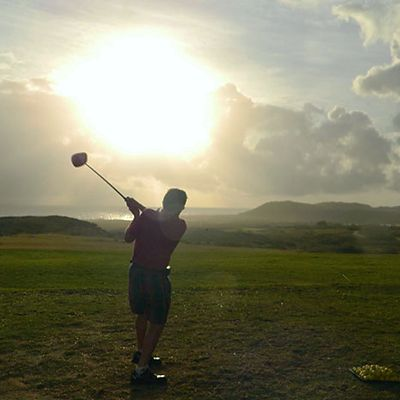 Caribbean golf course, golfer swinging