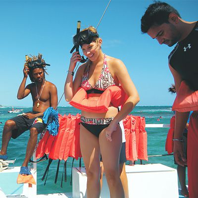 Caribbean guest on boat preparing to snorkel